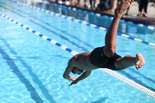 boy diving into a pool